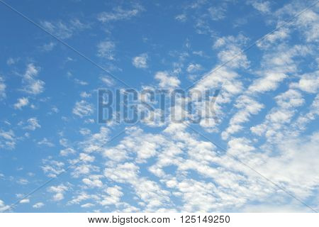 Sign of good weather high Cumulus or Altocumulus clouds in deep blue spring sky