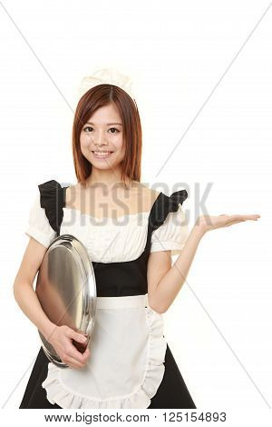 young Japanese woman wearing french maid costume with tray