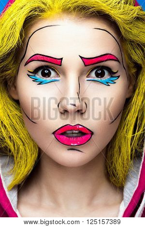 Photo of surprised young woman  with professional comic pop art make-up. Creative beauty style. Photos shot in studio