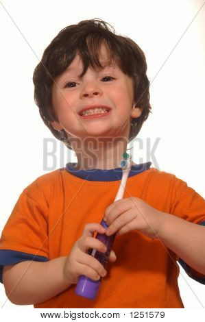 The Boy With A Toothbrush In He'S Hands