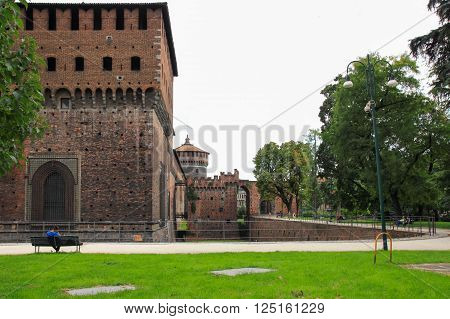 fragment of the fortress wall, the moat and corner tower of the Sforzesco Castle