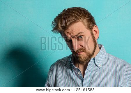 displeased rockabilly man vintage fifties style on blue background