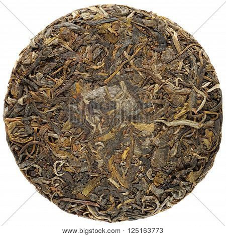 Young raw puerh cake overhead view isolated