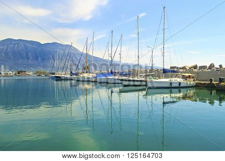 sailboats reflected on sea at Kalamata harbor Peloponnese Greece