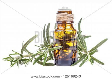 Essential oil made from rosemary on a white background