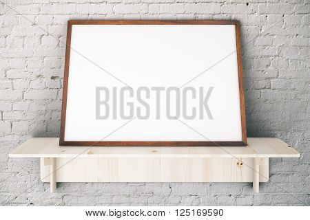 Wooden shelve with blank picture frame on white brick wall. Mock up 3D Rendering
