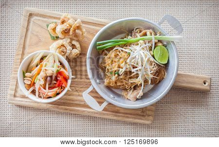 Thai Food, Fried Noodles Thai Style With Papaya Salad And Pork Crackling