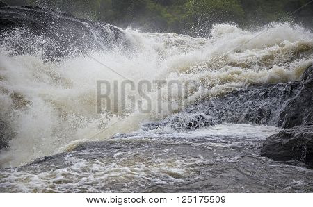 One of the waterfalls breaking into the Victoria Nile river at Murchison Falls National Park in Uganda, Africa