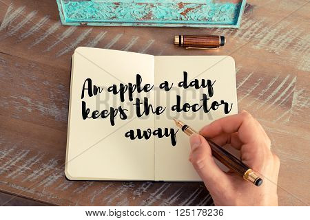 Handwritten quote An apple a day keeps the doctor away