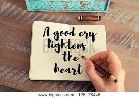 Handwritten quote A good cry lightens the heart