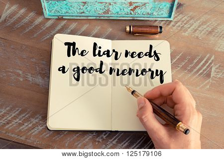 Handwritten quote The liar needs a good memory