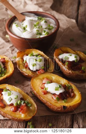 Baked Potato Skins With Cheese, Bacon And Sour Cream Close-up. Vertical