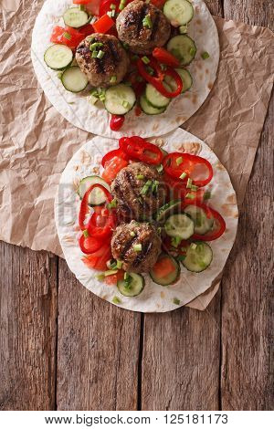 Grilled Meat Balls With Fresh Vegetables On A Flat Bread. Vertical Top View