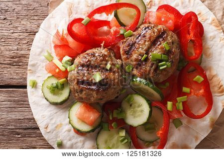 Meatballs with fresh vegetables and Flatbread close-up. Horizontal top view
