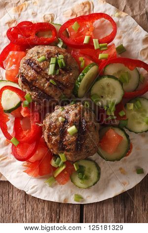 Meatballs with fresh vegetables and Flatbread close-up. vertical top view