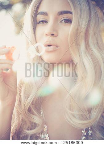 Beautiful Blonde Blowing Bubbles
