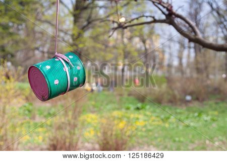 Colored feeding for the wild birds made from tin can