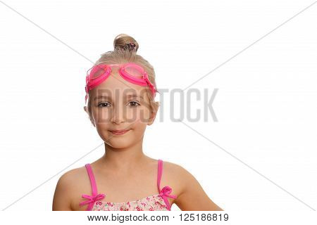 Cute girl swimmer in swimming costume and goggles