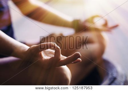 Closeup of woman's hands meditating indoors