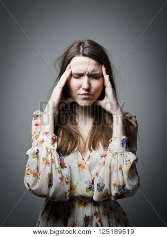 Headache. Expressions feelings and moods. Young woman suffering from headache