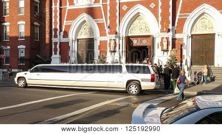 Brooklyn New York - April 18 2008: Stretch white limo waiting for newlyweds before Saint Anthony Church at Greenpoint