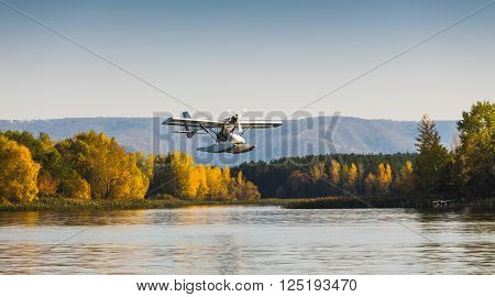 Seaplane flying over the bay near the island