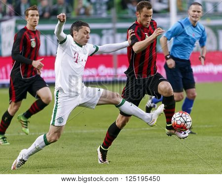 BUDAPEST, HUNGARY - APRIL 10, 2016: Vladan Cukic of Ferencvaros (l) duels for the ball with Marton Eppel of Honved during Ferencvaros - Budapest Honved OTP Bank League football match at Groupama Arena.