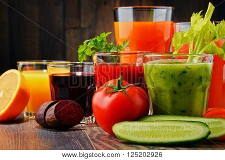 Glasses with fresh organic vegetable and fruit juices. Detox diet poster