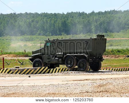 MOSCOW REGION  - JUNE 18:   New military all terrain truck for the transportation of personnel on a march over rough terrain-  on June 18, 2015 in Moscow region