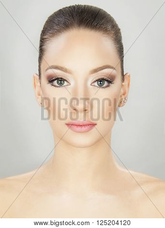 Girl with dry skin problem and magnifier macro skin pores, on green background