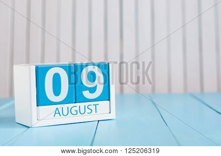 August 9th. Image of august 9 wooden color calendar on white background. Summer day. Empty space