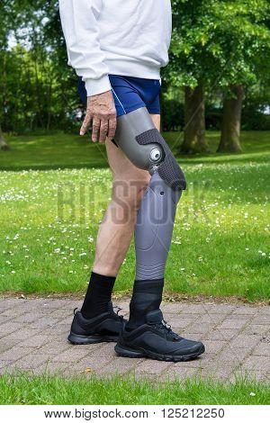 Close Up On Legs Of Man Walking On Path
