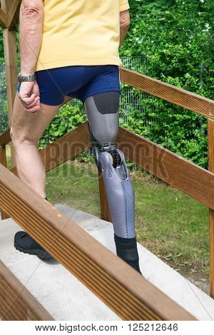Unidentifiable Man Going Over Ramp With False Leg At Exercise Course.