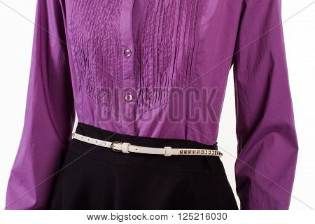 Purple shirt with small belt. White female belt on mannequin. Woman's trendy leather belt. Fashionable belt for evening outfit.