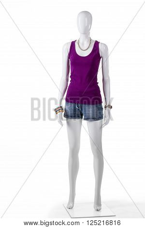 Mannequin in purple tank top. Girl's simple purple tank top. Denim shorts with purple top. Teenage girl's clothing on sale.