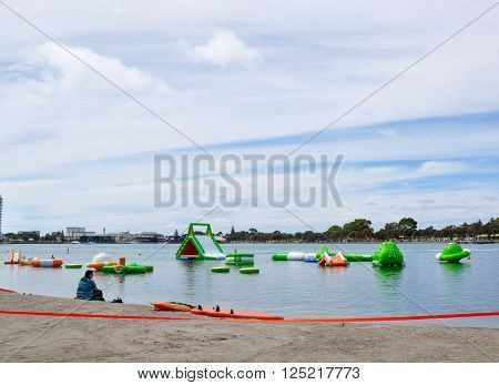 MANDURAH,WA,AUSTRALIA-MARCH 7,2014: Tourist, foreshore and inflatable water obstacle course on the Peel-Harvey Estuary in Mandurah, Western Australia.