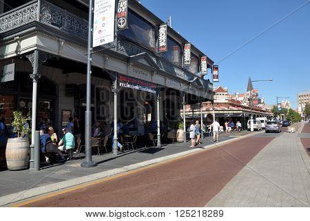 FREMANTLE,WA,AUSTRALIA-FEBRUARY 21,2015: Downtown street with restaurants, people and Fremantle Markets in historic Fremantle, Western Australia.