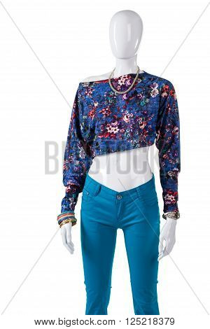 Crop top with turquoise pants. Female mannequin in crop top. Stylish asymmetric top for women. New top on store showcase.