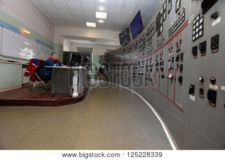 IVANGOROD, LENINGRAD OBLAST, RUSSIA - MARCH 29, 2016: Engineer in the control center of Narvskaya Hydroelectric Power Plant. Built in 1956, it has nameplate capacity 125 MW