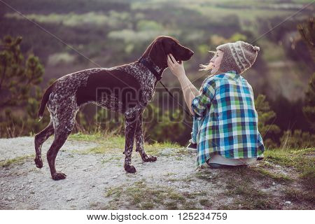 Woman and her dog posing outdoor. Active lifestyle with dog.