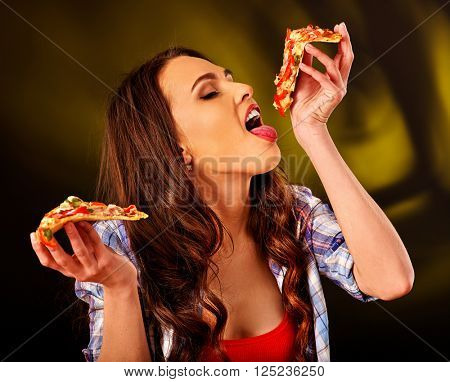 Beautiful girl holding piece of pizza. Fastfood concept.