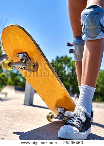 Legs skateboard close up  in skatepark. Lower plan. Foot on a skateboard.