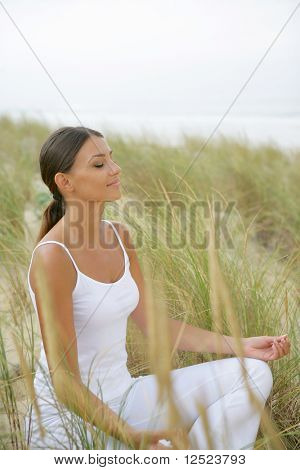Woman in lotus position in nature