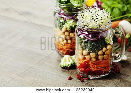 Healthy Homemade Mason Jar Salad with Chickpea and Veggies - Healthy food, Diet, Detox, Clean Eating or Vegetarian concept