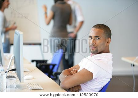 Portrait of young man relaxing in class