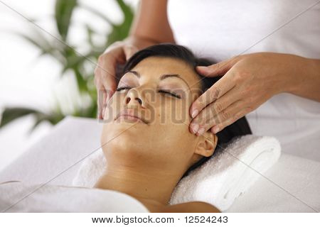 Woman having a face massage poster