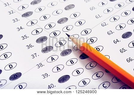 Exam test sheet with pencil. Education concept