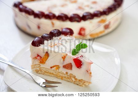 Cake with strawberries gelly yogurt and cherries isolated on white background in a plate ** Note: Shallow depth of field