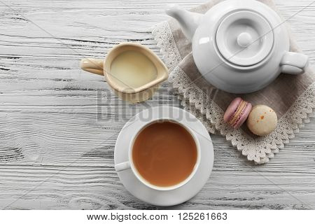 Milk tea with tea pot on white background.