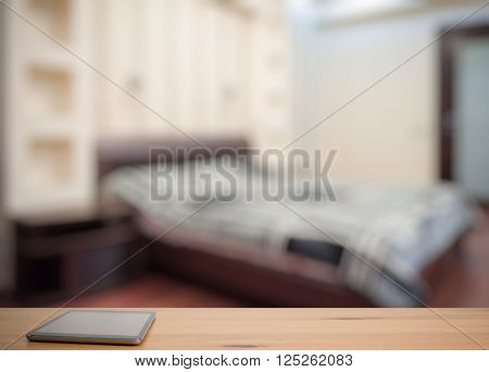 tablet on wooden table in the bedroom